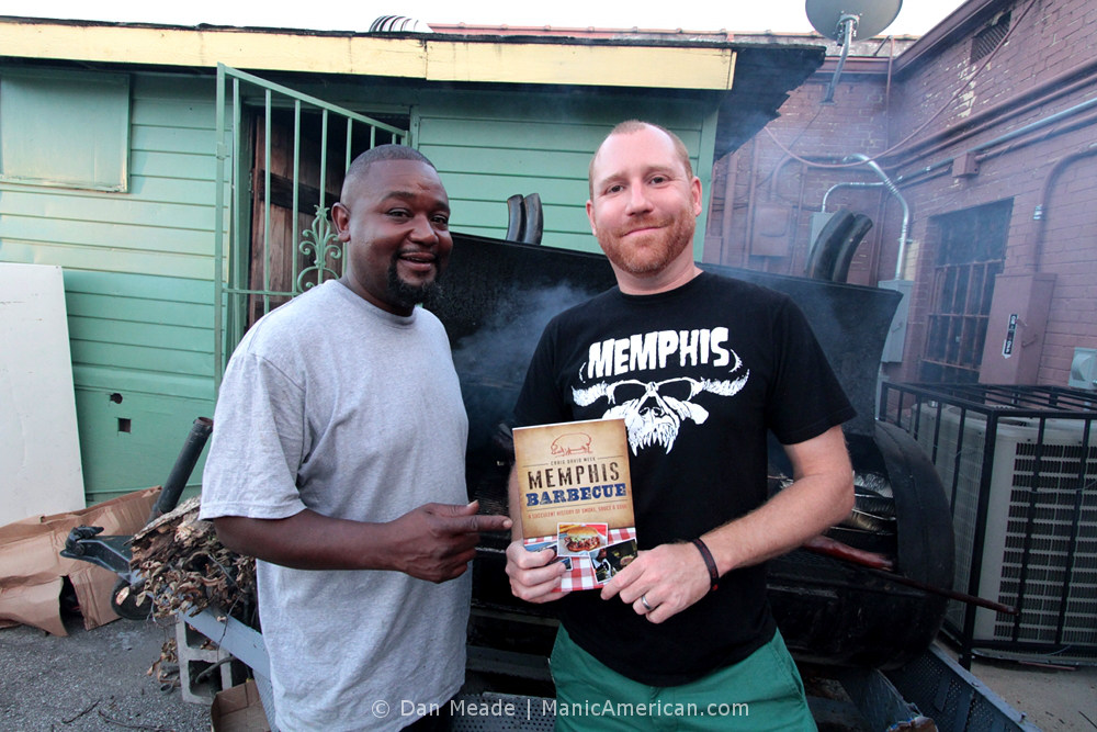 Craig Meek and Richard Forrest pose by the smoker.