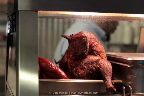 Belinda's assistant behind a display chicken.