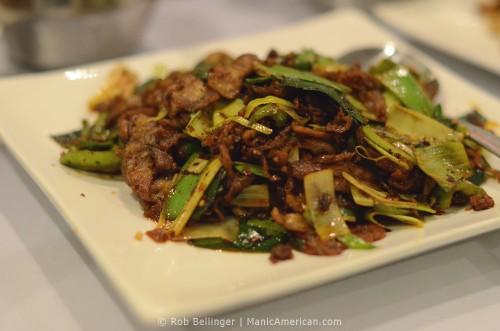 Food photo showing sliced pork belly with leeks