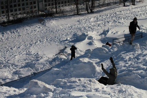 People sledding.