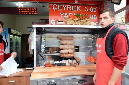 Street vendor grilling stuffed lamb intestines