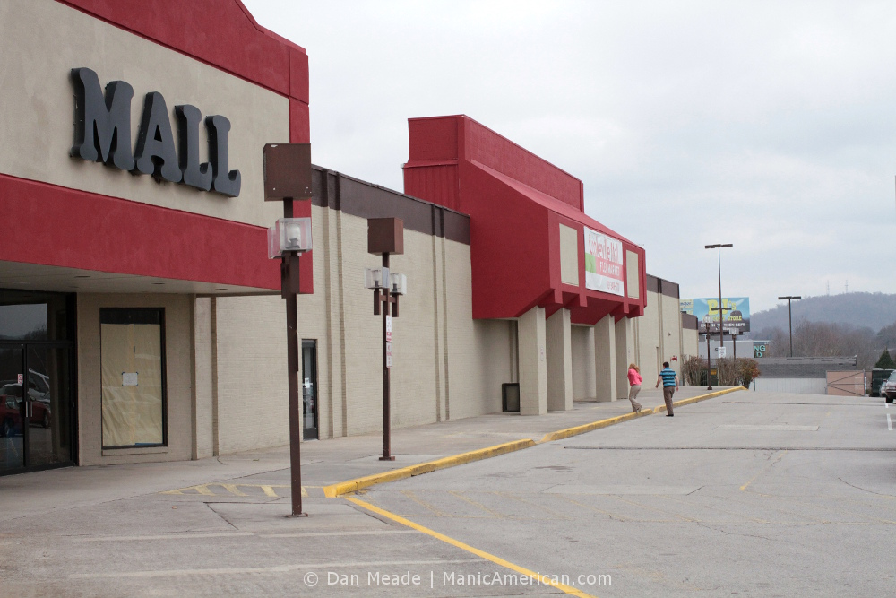 The exterior and parking lot of a windowless mall