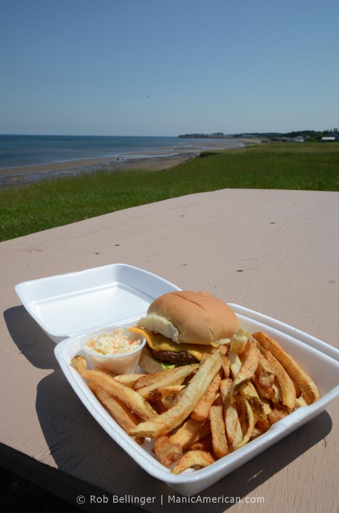 burger platter on beachside picnic table