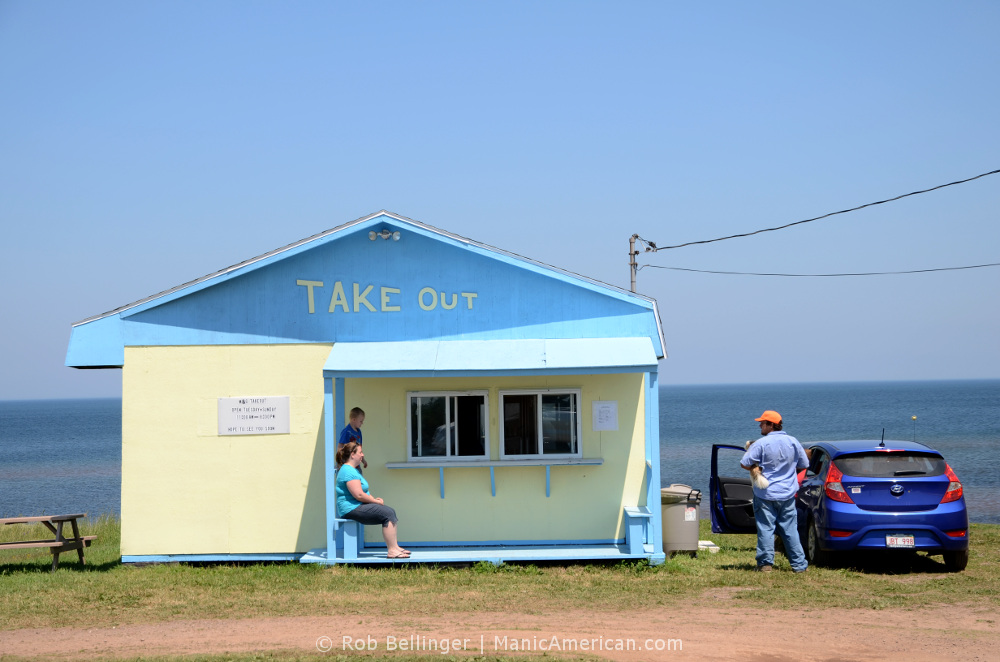 Vacationers wait for their burgers outside the burger shack shack