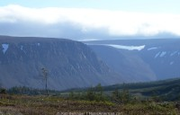 Snow sits atop the tablelands of Gros Morne, rugged, flat-topped mountains. Gros Morne, Newfoundland.