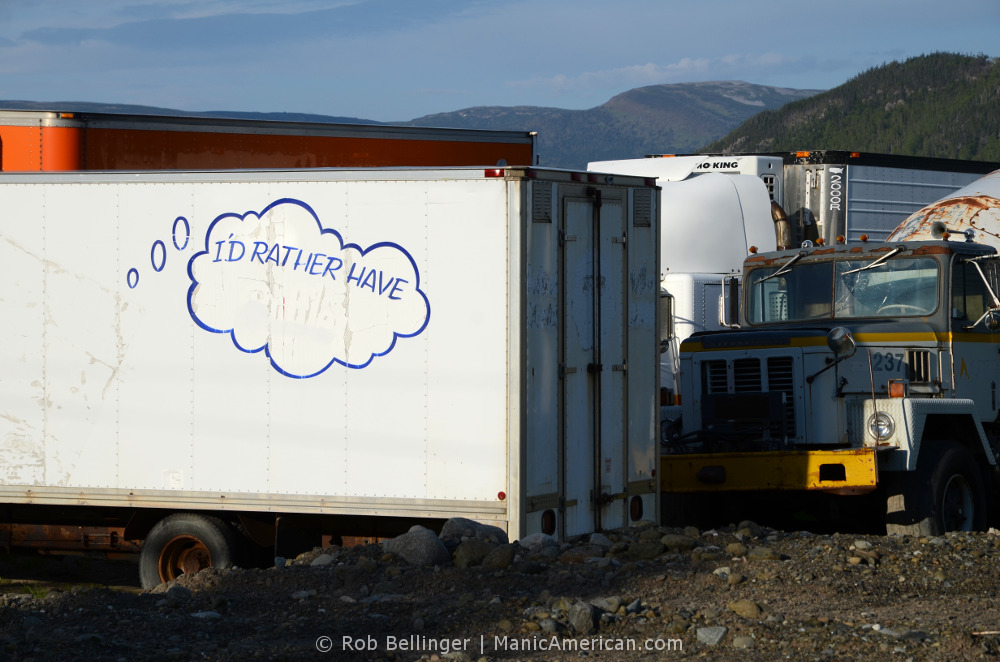 "In a lot of abandoned trucks, one truc reads ""I'd rather have."" Bonne Bay, Newfoundland."