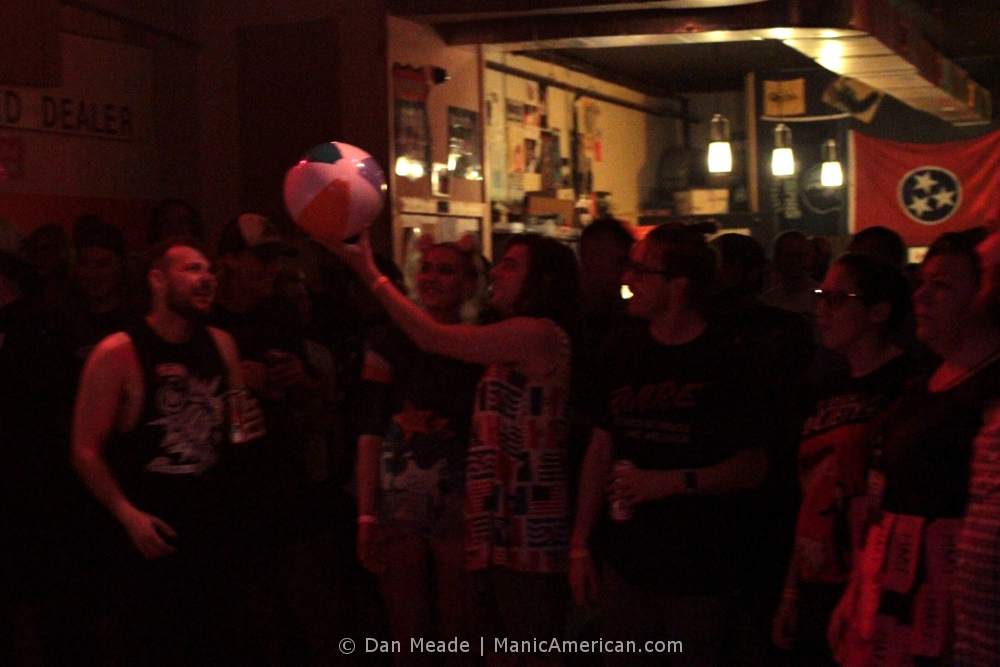 the crowd plays with a beach ball