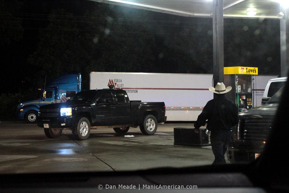 a cowboy exists his car
