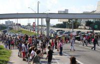 Marcher halt traffic on I-395