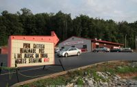 A roadside sign points the way to Roy's Kentucky barbecue.