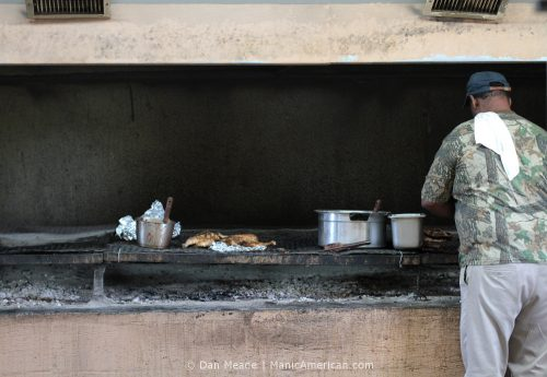 A worker tends the grill at R&S BBQ, a Kentucky barbecue restaurant.