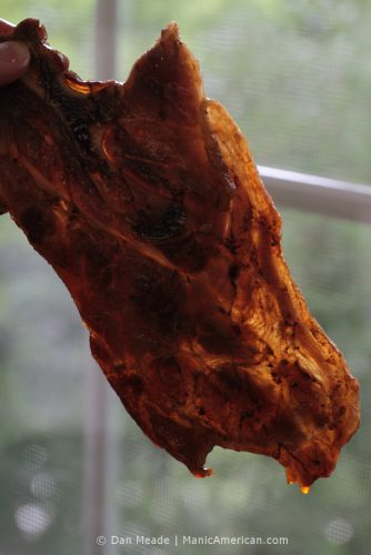 Kentucky barbecue: A Smokey Pig pork should is held up to the light.