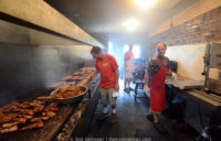 Three men work in the cookhouse of the Smokey Pig Kentucky barbecue restaurant.