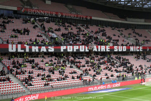 """The """"ultras"""" section of OGC """"ultras"""" fan wear giletes jaunes at Allianz Riviera filling up with fans wearing gilets jaunes."""