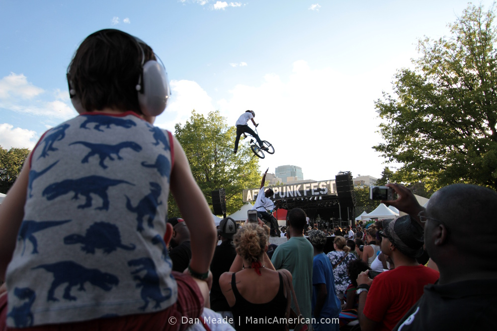A child watches BMX stunts.