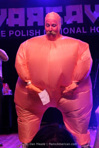 A man in an inflatable suit at the 2012 NYC Beard and Moustache Competition.