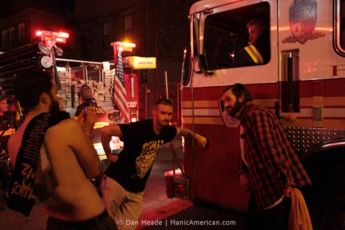 GWAR fans pose in front of a FDNY fire engine.