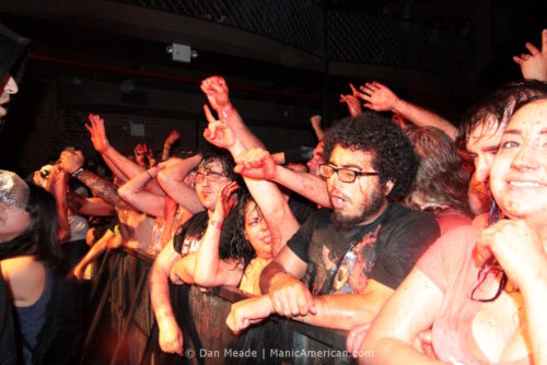 Fans covered in fake blood.