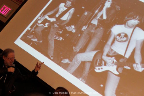 Tommy Ramone points to a photo of the band.