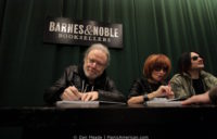 Tommy Ramone signs a book.