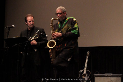 Wayne Kramer's horn section plays at Lincoln Center.