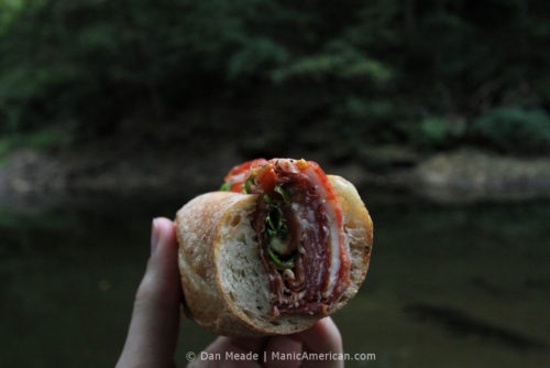 a cross-section of an Italian cold cut sandwhich