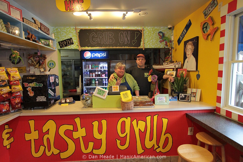 """Deena """"Mary"""" Eskew and Brian """"Hoss"""" Coddins behind the counter of their restaurant."""