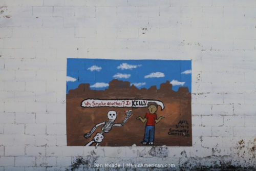 """A mural reading, """"Why smoke another? It kills!"""""""