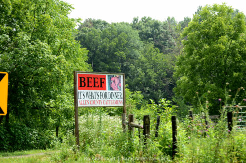 """A roadside sign reads """"BEEF IT'S WHAT'S FOR DINNER"""" and is signed Allen County Cattlemens"""