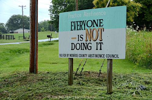"""A roadside sign promoting abstinence reads """"EVERYONE IS NOT DOING IT"""""""