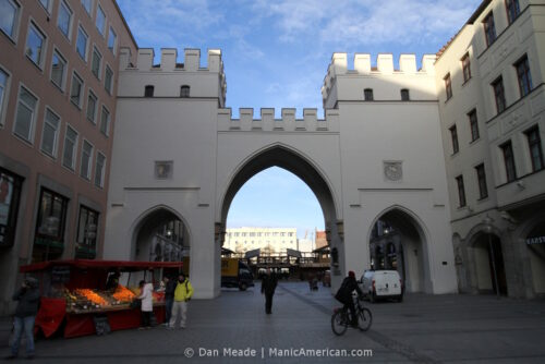 Munich's Karlstor gate, with a fruit stand.