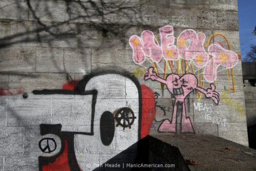 "Graffiti reading, ""MEAT IS LOVE."""