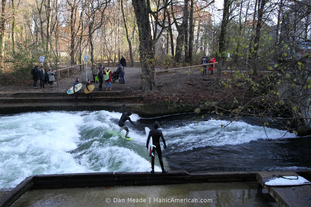 A surfer at Munich's Eisbachwelle river surfing.