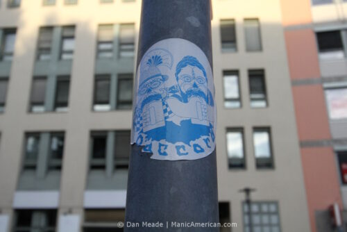 A sticker by D'ACCORD showing a candy skull Oktoberfest couple.