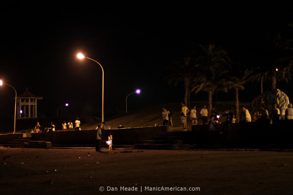 Taiwanese people along the shore of Hualien at night.