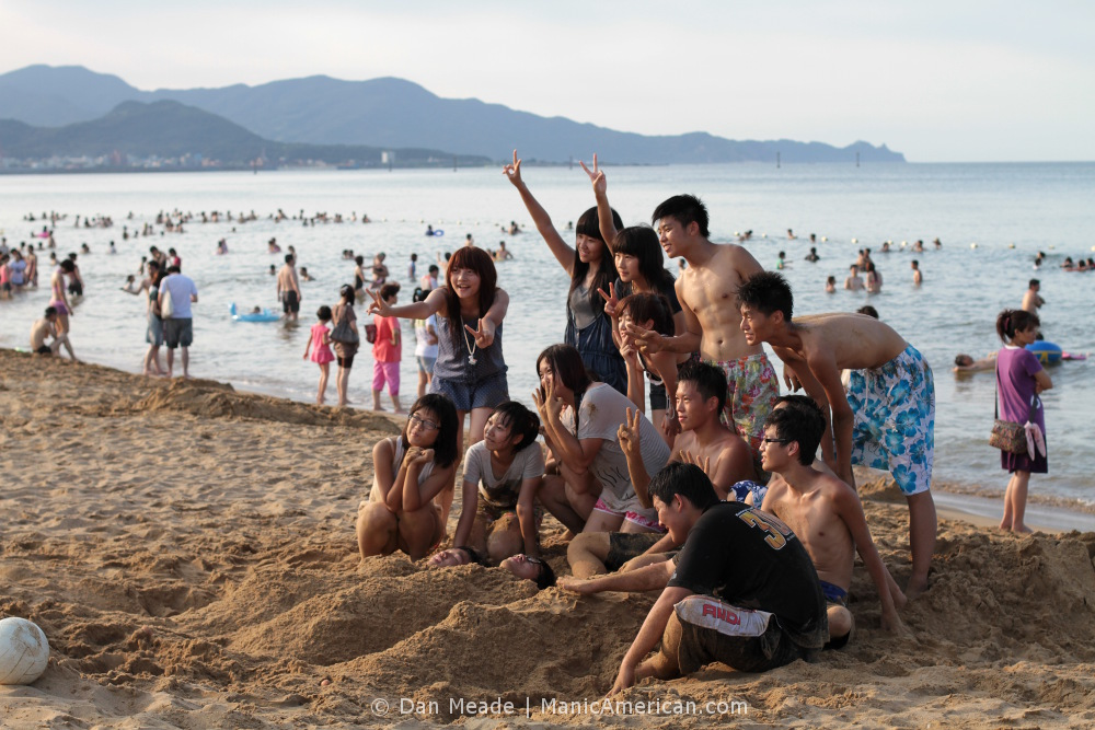 A group of Taiwanese people pose for a picture at Fulong beach.