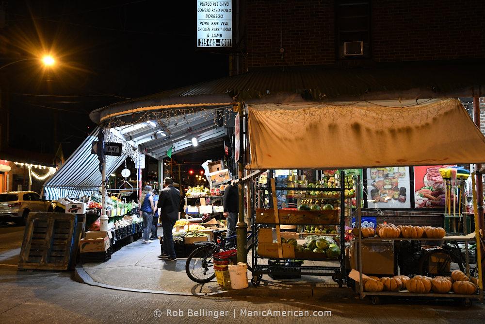A produce market at night