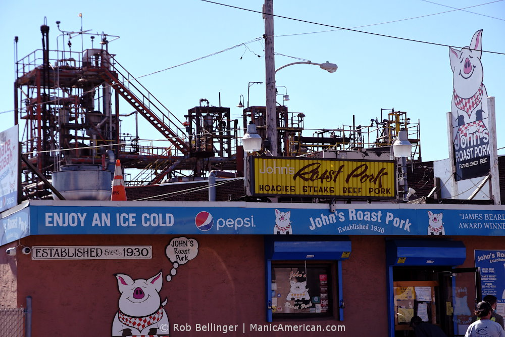 a roast pork hoagie restaurant in front of a chemical plant