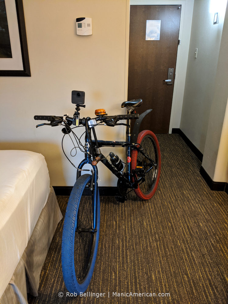 a bike with red and blue tires in a hotel room