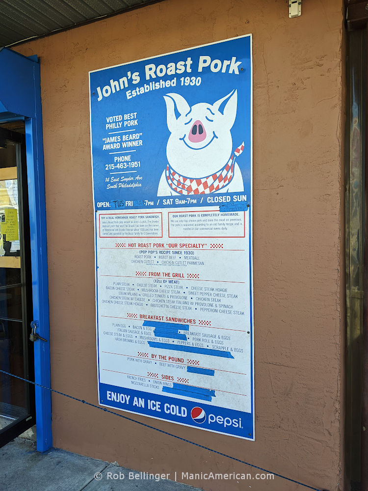 a large printed hoagie menu tacked to an exterior wall