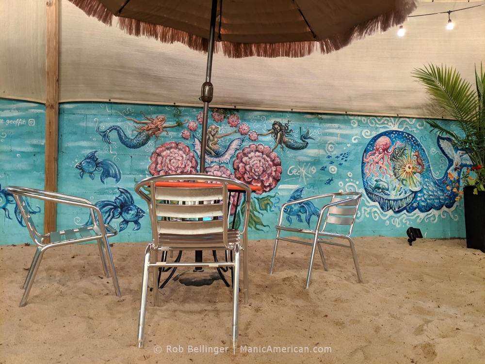 chair and tables on sand covered dining area at mara's in rockaway beach