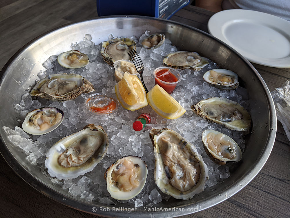 shucked oysters and clams on a plate of ice at bungalow bar in rockaway beach